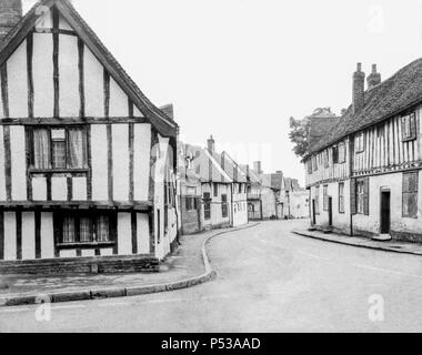 Half-timbered medieval buildings (The Swan Hotel & Water Street) in Lavenham, Suffolk UK taken on a paper negative on a 5x4 camera around 1972. - Stock Photo