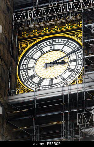 Big Ben clock still working while the tower is covered in scaffolding during refurbishment of the Houses of Parliament, June 2018. - Stock Photo