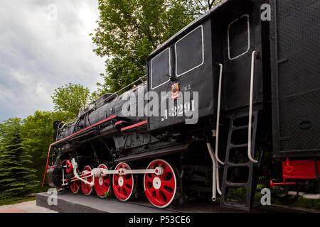 The locomotive-monument L-3291. Powerful, beautiful Russian locomotive. - Stock Photo