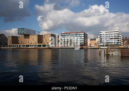 Berlin, Germany - View over the Spree at the Osthafen on historical and modern architecture on the Spreeufer in Friedrichshain. - Stock Photo