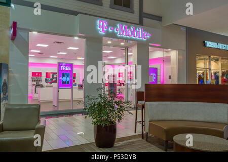 UTICA, NEW YORK, USA - JUNE 23, 2018: T-Mobile cellular operator shop in Sangertown Mall New Hartford, New York. - Stock Photo