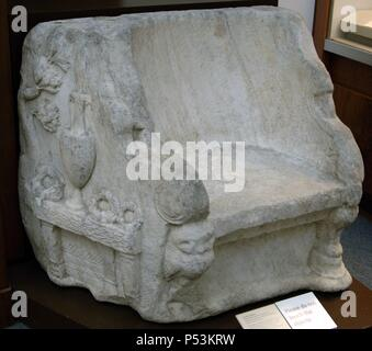 The Biel Throne. Marble. The right side are a reliefs showing an olive tree and a table on which there rests a Panathenaic amphora, containing an olive spray and three wreath. The front legs are in the form of owls. 140-143 AD. From the roman Panathenaic Stadium, Athens. British Museum. London. England. United Kingdom. - Stock Photo
