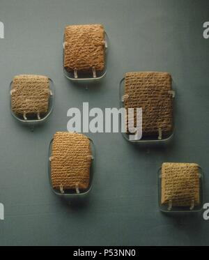 Amarna Letters. 14th century BC. Clay tablets with cuneiform script, mostly written in Akkadian. Designate a file of correspondence, mostly diplomatic, between the Egyptian administration and its representatives in Canaan and Amurru. 1350-1330 BC. From Amarna (Upper Egypt). British Museum. London. United Kingdom. - Stock Photo