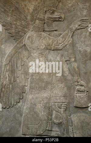 Relief depicting a Eagle-headed protective spirit. 865-860 BC. From Northwest Palace. Nimrud. British Museum. London. United Kingdom. - Stock Photo