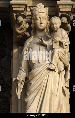 Gothic Art. France. Paris. Notre Dame. Portal of the Virgin (c. 1220). Trumeau. Virgin and Child. - Stock Photo