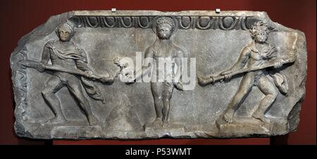 Relief depicting a cult statue of Apollo, standing between two torch-bearers. The image of god are a quotation from a famous archaic cult statue by Kanachos. 175-200 AD. Marble. From the theater of Miletus. Pergamon Museum. Berlin. Germany. - Stock Photo