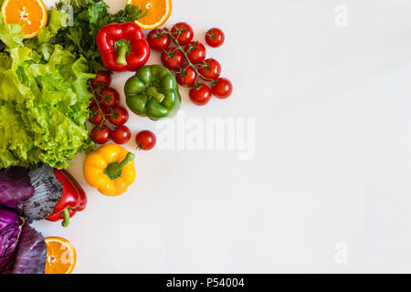 Fresh colorful organic vegetables on a white background, farming and healthy food concept. Copy space. Flat lay - Stock Photo
