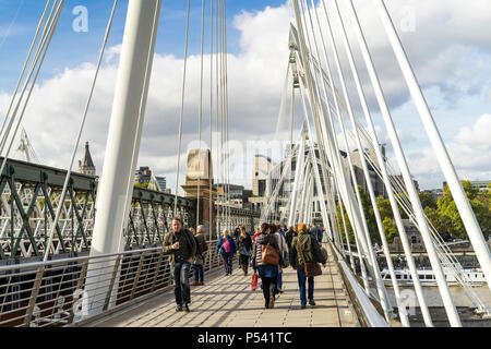 London Great Britain, October 12 2017, People walking on Golden Jubilee Bridge, Nice sunny autumn day in the city - Stock Photo