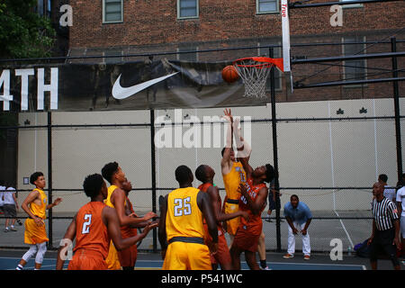 NEW YORK, NY - JULY 12: Players scrambling for the ball under the board while playing basketball in 'The Cage', West 4th Street Courts, Manhattan on J - Stock Photo