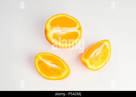 Sliced and cut orange fruit on white background. Details of nice good organic vegetarian food ingredient. Fresh, natural, ecological clean eating - Stock Photo