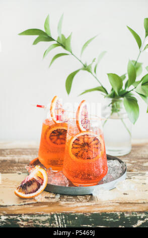 Two glasses of Italian Aperol spritz alcohol cocktail with ice and blood orange slices. Summer refreshing cocktail drink - Stock Photo