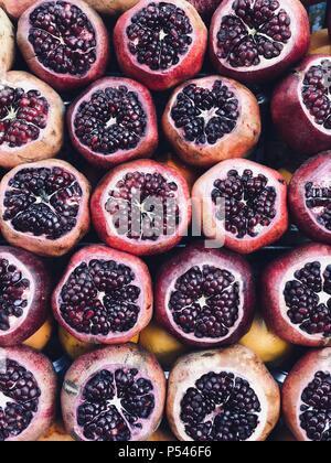 Pomegranates for making fresh juice - Stock Photo