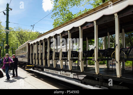 Passengers on platform outside old Manx Electric Railway / Tramway train carriages in the station. Laxey, Isle of Man, British Isles - Stock Photo