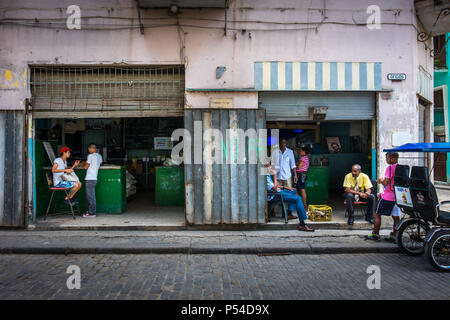 HAVANA, CUBA - CIRCA MAY 2016: Typical corner in centro Havana with locals. - Stock Photo