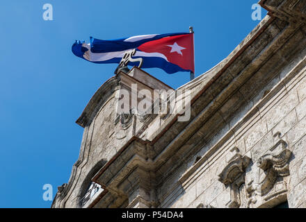 HAVANA, CUBA - CIRCA MAY 2016: Cuban Flag over the 'Palacio De los Capitanes Generales' in Havana. - Stock Photo