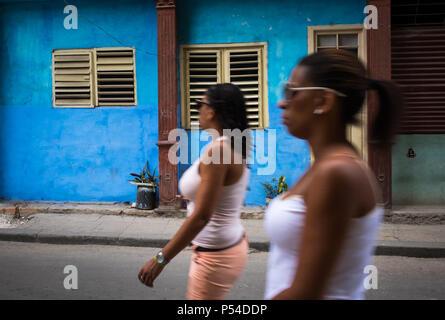 HAVANA, CUBA - CIRCA MAY 2016:  Women walking in the streets of Old Havana, Cuba. - Stock Photo
