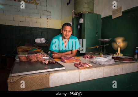 HAVANA, CUBA - CIRCA MAY 2016:  Butcher in Old Havana, Cuba. - Stock Photo