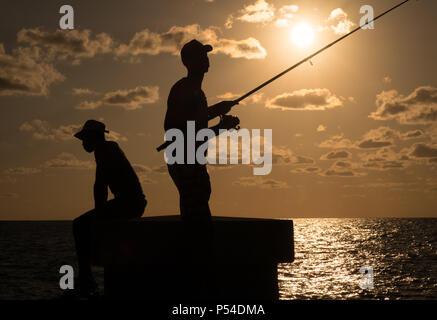 HAVANA, CUBA - CIRCA MAY 2016:  Man fishing from the Malecon in Havana, Cuba. - Stock Photo