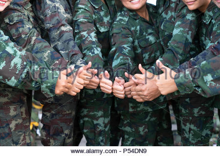 Soldier many thumbs up - Stock Photo