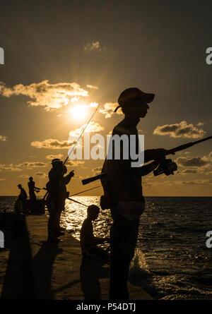 HAVANA, CUBA - CIRCA MAY 2016:  People fishing from the Malecon in Havana, Cuba. - Stock Photo
