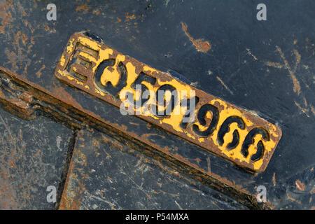 embossed number in rundown peeling metallic ambiance - Stock Photo