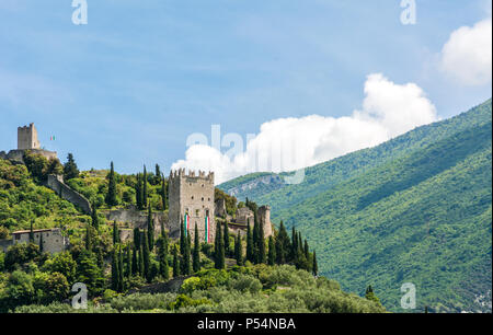 Arco Castle (Castello di Arco) is a ruined castle located on a prominent spur high above Arco and the Sarca Valley in Trentino Alto Adige, Italy - Stock Photo