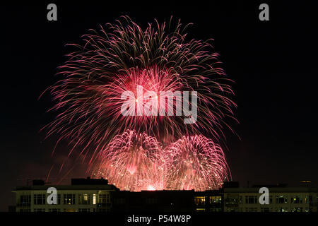 Fireworks over downtown Seattle at night on independence day. - Stock Photo