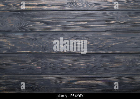 Dark gray background of wooden old rustic table, planks texture, wood wall. - Stock Photo