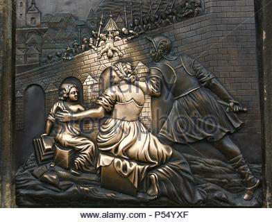 St. John of Nepomuk (1345-1393). National saint. Relief depicting his martyrdom. He was thrown into the river by order of King Wenceslas IV of Bohemia. Plaque on the pedestal of the statue of St. John. Charles Bridge. Prague. Czech Republic. - Stock Photo