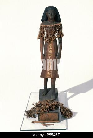 Statue of the architect Kha. Polychromed wood. Tomb of Kha (Deir el-Medina). 1400 BC. New Kingdom. 18th dynasty. Egyptian Museum. Turin. Italy. - Stock Photo