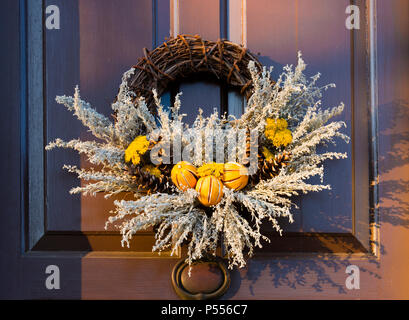 Split peel dried oranges and pine cones wreath on door. Entry in annual Christmas natural materials wreath competition in Colonial Williamsburg, VA. - Stock Photo