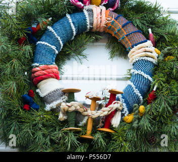 Beautiful textiles Christmas Wreath entered in the annual Colonial Williamsburg natural materials wreath competition. Spools, died cloth and braids. - Stock Photo