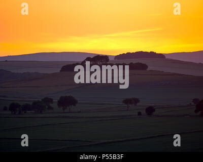 Harborough Rocks, Peak District, UK. 24th June, 2018. Weather UK: Sunset over Minning Low hill Historic England monument with a chambered tomb & two bowl barrows viewed from Harborough Rocks, Peak District National Park, Derbyshire, UK Credit: Doug Blane/Alamy Live News - Stock Photo