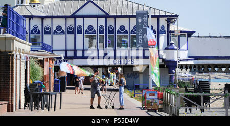 Eastbourne UK 25th June 2018  - Preparing for a hot day on Eastbourne seafront this morning as temperatures are expected to reach 30 degrees in the South East today Credit: Simon Dack/Alamy Live News - Stock Photo