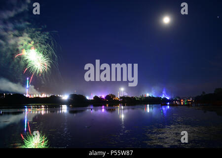 Newport, Isle of Wight, UK. Fireworks and a near full moon herald the end of the last day of the Isle of Wight Festival 2018. - Stock Photo