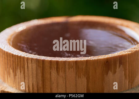 beer in a wooden mug on a background of ripe juicy summer - Stock Photo