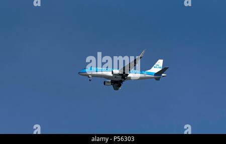 Southampton, England UK. 2018. A KLM Embraer ERJ passenger jet on finals into Southampton International Airport. - Stock Photo