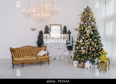 The bedroom decorated by Christmas. In the room there is a New Year's fir-tree decorated with toys and garlands. - Stock Photo