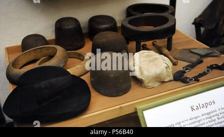 Manufacture of felt hats, formerly widely used in Hungary. Reflects the regional differences, social and occupational. Ethnographic Museum. Budapest, Hungary. - Stock Photo