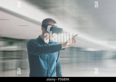 A man in virtual reality glasses. Technology of the present and the future - Stock Photo