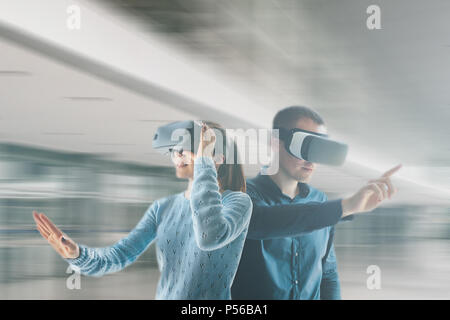 A young woman and a young man in virtual reality glasses.The concept of modern technologies and technologies of the future. VR glasses. - Stock Photo
