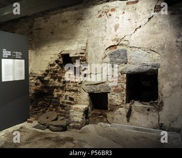 Aboa Vetus & Ars Nova . Aboa Vetus. Includes the remains of six medieval buildings. The urban character of the area can be seen in the ruins and the old cellars. The Convent Riverfront, one of medieval Turku's main streets. Ruin of winery. Finland. Turku. - Stock Photo
