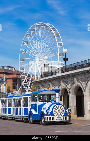 Landtrain and big wheel at promenade and Pier Approach, Bournemouth, Dorset, UK on hot sunny day in June - Stock Photo