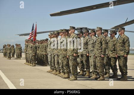 Marines with Special Purpose Marine Air-Ground Task Force - Southern Command stand at attention awaiting orders from the commander of troops during the unit's opening ceremony aboard Soto Cano Air Base, Honduras, June 11, 2018, June 11, 2018. The Marines and sailors of SPMAGTF-SC will conduct security cooperation training and engineering projects alongside partner nation military forces in Central and South America during their deployment. The unit is also on standby to provide humanitarian assistance and disaster relief in the event of a hurricane or other emergency in the region. (U.S. Marin - Stock Photo