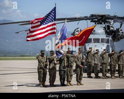 A multinational color guard comprised of Marines with Special Purpose Marine Air-Ground Task Force - Southern Command and a Honduran Army soldier present colors during an opening ceremony on Soto Cano Air Base, Honduras, to mark the beginning of SPMAGTF-SC deployment to Latin America and the Caribbean, June 11, 2018, June 11, 2018. The Marines and sailors of SPMAGTF-SC will conduct security cooperation training and engineering projects alongside partner nation military forces in Central and South America during their deployment. The unit is also on standby to provide humanitarian assistance an - Stock Photo
