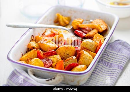 Chorizo, potatoes, red pepper & onion in baking dish - Stock Photo