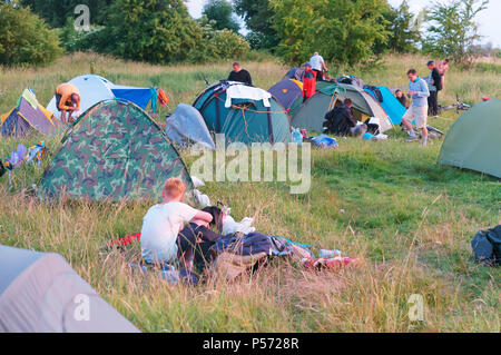 10 June 2018, Kaliningrad region, Russia, campground, tourist tents, pitching camp travelers - Stock Photo