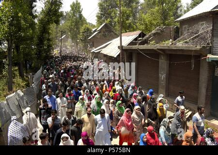 June 25, 2018 - Kulgam, Kashmir, India - Thousands of people take part in the funeral procession of Lashkar-e-Toiba commander Shakoor Ahmad Dar at his native village in Devsar area of South Kashmir's Kulgam district on Monday, 25 June 2018 in Indian-Administered-Kashmir. Rebels also surfaced during the funeral and offered gun salute to slain rebel. Dar along with an associate was killed during a gunfight with government forces in adjoining area of kulgam district while his third associate was captured alive. A civilian was also killed during the clashes that erupted near the site of the gunfig - Stock Photo