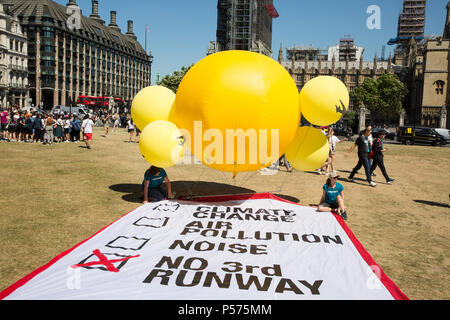 London, UK. 25th June 2018. A Greenpeace inflatable in Parliament Square on the day of the vote in the House of Commons on whether or not to approve Heathrow expansion. Greenpeace is opposed to plans to expand Heathrow airport. Credit: Mark Kerrison/Alamy Live News - Stock Photo
