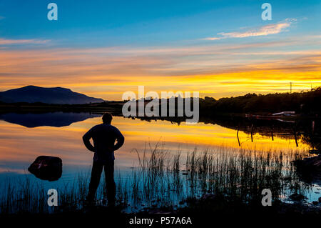 Ardara, County Donegal, Ireland weather. 25th June 2018. Watching the sunset over Lake Shanaghan on the west coast of Ireland. Credit: Richard Wayman/Alamy Live News - Stock Photo